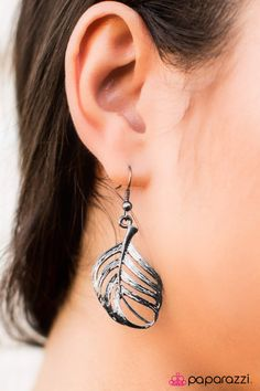 """Etched in lifelike textures, a glistening gunmetal feather swings from the ear in a free-spirited, whimsical fashion. Earring attaches to a standard fishhook fitting.   Sold as one pair of earrings.   Get The Complete Look!  Necklace: """"At First FLIGHT"""" (Sold Separately)"""
