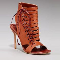 Manolo Blahnik cut-out sandles in my collection.  I adore these shoes!!