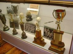 Trophies and photos from the early sports teams of Middleton #visitmiddleton (Photos: Middleton Area Historical Society)