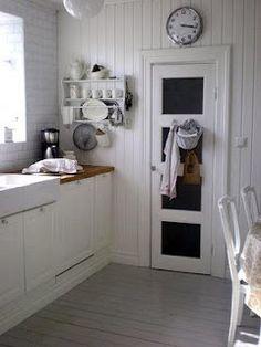 chalkboard door, gray painted floors....
