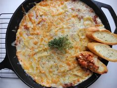 Lasagna Dip A great hearty easy appetizer for parties or just for an easy no mess family dinner. Cheesy, meaty, saucy and the perfect scrumptious dip with chips, fresh bread or toasted garlic crostini's!