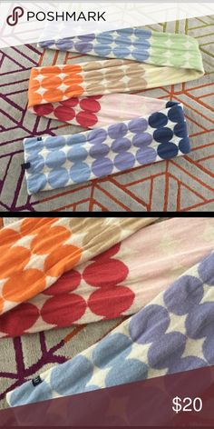 Beautiful and WARM Gap Scarf Super cute Gap scarf!!! Big multicolored polka dots! This is super long. Measures about 8.5 FEET LONG! Definitely awesome for super cold weather and wrapping yourself up in! It's about 6.5 INCHES wide. I'm exactly sure what the material is. Feels like wool to me. I believe this was a special edition scarf. Smoke free home. I do own a cat but manage to keep him out of my closet. Make an offer! GAP Accessories Scarves & Wraps