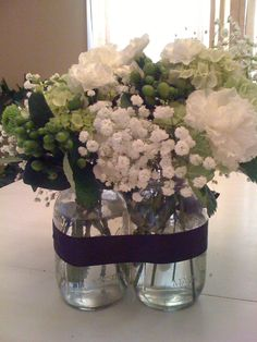 Mason jars for center pieces.wrap 3 babies together with purple ribbon