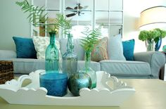 Pretty turquoise, blue and green decor. Like the idea of the ferns