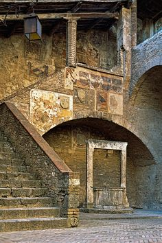 The courtyard inside the Palazzo Comunale of San Gimignano, built in 1288. The town of San Gimignano, near Siena, Tuscany, Italy is one of the best preserved examples of medieval architecture in Italy.