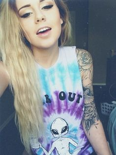 She's hot. Real hot. And that shirt....Idk what I like most....It might be the shirt. But that sleeve is nice too