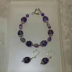 Check out this item in my Etsy shop https://www.etsy.com/listing/481854130/amethyst-and-dragon-veins-agate-bracelet