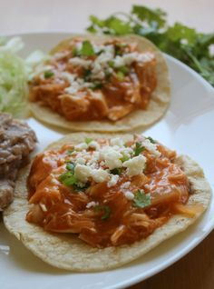 Jazz up your weeknight meals with Chicken Tinga Tostadas. This dish is a classic Mexican favorite that comes together easily and deliciously.
