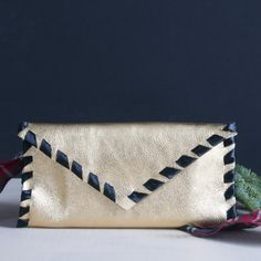This no-sew leather envelope clutch is a fabulous gift idea and can me made with real or faux leather!  All it takes is leather and ribbon!
