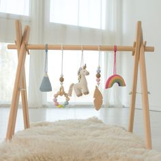 Baby play gyms, baby gym toys, musical toys, rattles by LanaCrocheting Baby Play, Baby Toys, Childrens Bedside Lamp, Wooden Feather, Feather Mobile, Play Gym, Frame Stand, Rainbow Unicorn, Unfinished Wood
