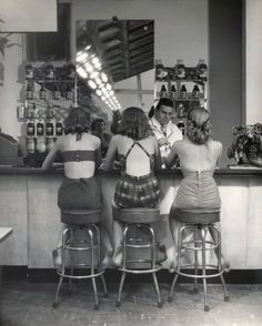 3 girls in swimsuits in a 1950s beach cafe