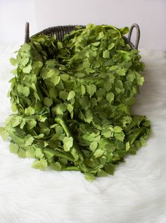 """Olive Grape Leaf Taffeta .Used in so many ways as you would faux fur. Under baby, draped over a basket or even a basket filler.  Sizes 18"""" x 20"""" $12.99 18"""" x 30 $17.99"""