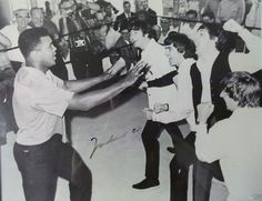 The Beatles trying to punch Muhammad Ali