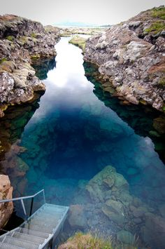 Silfra Crack, Iceland. The ladder that takes you into the crack. Glacier water filtered through miles and miles of volcanic rock feed Lake Þingvallavatn making it extraordinarilty clear.
