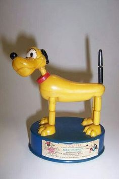Disney Pluto Collasping Dog. Push the button on the underneath side & his legs collasped.  I had one just like this.  1950's