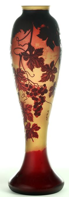 IMAGE: A Galle art glass Cameo vase, France early 20th century. Baluster with red leaves and grapes clusters, cut to a yellow ground
