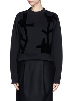 Superimposed with an abstract geometric bird and potato pattern at the front, this tonal flocked sweatshirt from Acne Studios imbues minimalistic charm with a patterned edge for a look of nonchalant cool. Cropped at the waist, this piece ensures a relaxed fit without drowning your silhouette.
