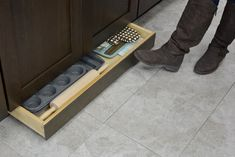 Toe Space Drawer opening with a touch of the toe - Kitchen Cabinet Extra Added Storage Idea from Dura Supreme Cabinetry