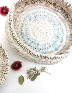 Baskets made from crocheted string over fabric scraps.