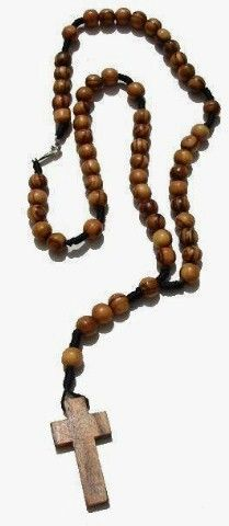 """This may look like a rosary, but it is meant to be worn or displayed. The hand-strung olive wood beads and olive wood cross close in the back with a silver clasp. So long as it isn't blessed, this fourteen inch long """"rosary"""" can be worn as a necklace or displayed in a locker, or around the read-view mirror in a car, without any disrespect to a blessed object! http://ourholyhome.com/products/olive-wood-rosary-necklace.html"""