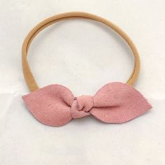 Hand cut and tied real leather knot bow. Bows measure 3, CLASSIC. You can have the bow attached to a clip or one size fits all soft nylon elastic.
