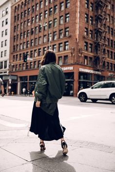 Dark green bomber jacket + black loose flowy maxi skirt + black strappy heels
