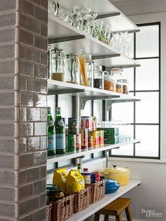 Open shelves in the pantry keep ingredients within reach and clear containers make it easy to determine contents for this open concept idea for your pantry.