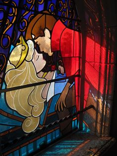 how cool would it be to have a library room and have stained glass of disney movies for the windows?