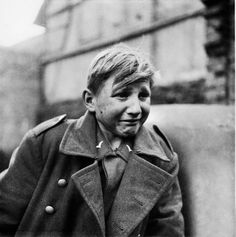 """nickdrake: """" A fifteen year old German soldier, Hans-Georg Henke, cries after being captured by the US Army in Rechtenbach, Germany, on April He was a member of the Luftwaffe anti-air squad (Flakhelfer) who burst into tears as his world. World History, World War Ii, Ww2 History, History Photos, German Boys, German Army, Hiroshima, Interesting History, Historical Photos"""