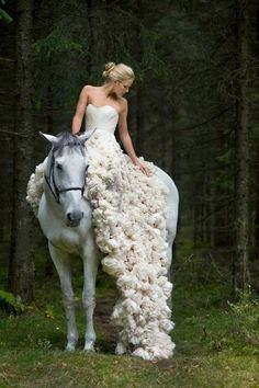 Leila Hafzi: Eco-Haute Couture Bridal. Bride on Horse in forest. White dress / gown.