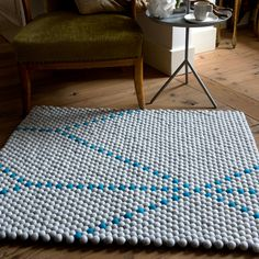 Scholten & Baijings rugs made out of felted balls stitched together by hand