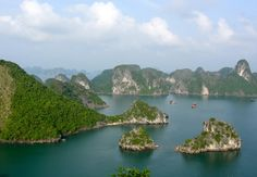 Ha Long Bay is a UNESCO World Heritage Site, and a popular travel destination, located in Quang Ninh province, Vietnam. The bay features thousands of limestone karsts and isles in various sizes and shapes. Ha Long Bay is a center of a larger zone which includes Bái Tử Long bay to the northeast, and Cát Bà islands to the southwest. These larger zones share similar geological, geographical, geomorphological, climate, and cultural characters.