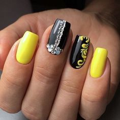 This rather a spectacular version of nail design is notable for the unexpected combination of black and yellow gel varnishes. A manicure looks bravely, so