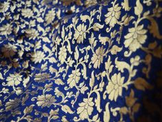This is a beautiful pure banarse silk brocade floral design fabric in Navy Blue and Gold. The fabric illustrate small golden woven floral vines on Navy Blue background.  You can use this fabric...