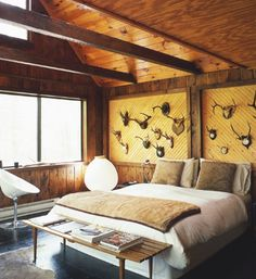 Country bedroom. His and hers antlers over the bed