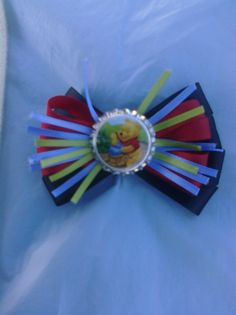 Winnie The Pooh BottleCap Hairbow  The bottle cap is epoxy covered, not waterproof. We have all kinds of images that we can create a hairbow from.