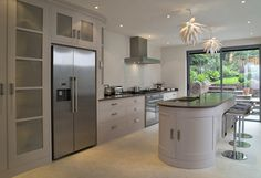 Plain framed kitchen by Tim Moss with tulip wood doors and frames finished in oil eggshell