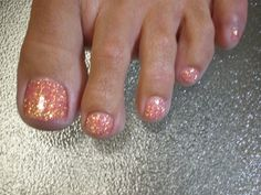 Nail Ideas. Pink toe nails with gold glitter.