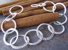 I love this bracelet the Family links....hand stamped and forged going to add the kids on this