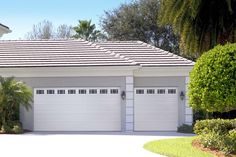 Amarr Short Panel garage door in True White with Prairie Windows. Available in Olympus, Heritage™, Lincoln, and Stratford® Collections. Visit www.amarr.com for more great styles.