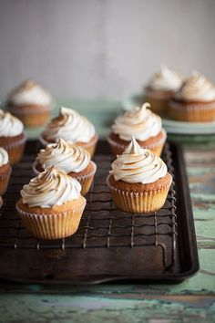 Lemon pistachio cupcakes with a honey meringue frosting