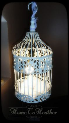 turn a decorative birdcage into a hanging lamp.  SO EASY!