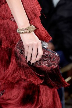 Marchesa red evening gown and beaded clutch