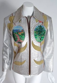 1970's East West Musical Instruments Handpainted Applique Silver Leather Jacket | From a collection of rare vintage jackets at https://www.1stdibs.com/fashion/clothing/jackets/