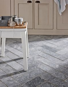 This stunning tile features a blue-charcoal background with slight light flecking. It's heavily tumbled creating an aged finished, full of rustic charm and character.