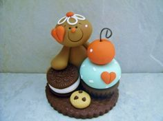A whimsical gingerbread man has a cupcake and cookies!  This is an original design thats been handcrafted from polymer clay. The figure stands approximately 3 tall. All parts have been secured with liquid polymer for increased strength.   Not a toy...not suitable for young children.
