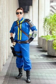 """Who are you dressed as? """"I'm dressed as the Vault 101 dweller from the series Fallout. In that game, the dweller is known as the lone wanderer. Fallout is a post-apocalyptic video game and has a very niche group of fans.""""What's she all about? """"When I play PS3, I like for my characters to use their charisma, intelligence, or stealth to achieve their objective rather than going in guns blazing. This cosplay reflects that; a more polished and refined character, not quite as dirty and grungy as…"""