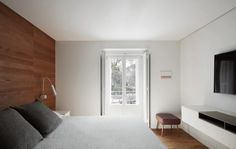 Lucas y Hernández-Gil revamp 19th-century Madrid flat with smooth finishes and colourful paintings
