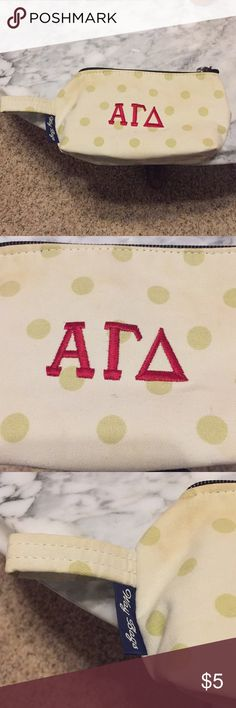 Alpha Gamma Delta Sorority Makeup Bag Alpha Gamma Delta sorority embroidered in red in middle of Bag. White and lime green polka dots. Loop on left side of bag. Does have some wear marks in the left corner and on the bottom as shown in photo. Has been washed. Bags Cosmetic Bags & Cases