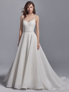 - KYLE, Comprised of Shavon Organza, this classic wedding dress features delicate beaded spaghetti straps and a beaded belt, both accented in Swarovski crystals. A sweetheart neckline completes this chic A-line gown. Finished with crystal buttons trailing to the hemline over zipper closure. #weddingdress #aline #atlasbridalshop #SotteroandMidgley #weddinggown #sweetheart #organza Simple Elegant Wedding Dress, Plain Wedding Dress, How To Dress For A Wedding, Western Wedding Dresses, Minimalist Wedding Dresses, Classic Wedding Dress, Sexy Wedding Dresses, Bridal Dresses, Lace Wedding